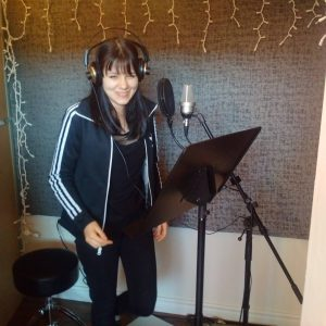 Culminating project for public speaking: write and record one's own speech at a professional recording studio with a voice coach!